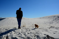David & Festus walking on the white sand at White Sands National Monument, New Mexico